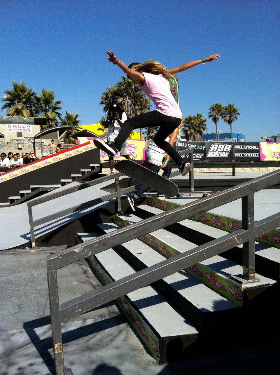 a quick iPhone photo of Jessica Florencio kickflipping the 5